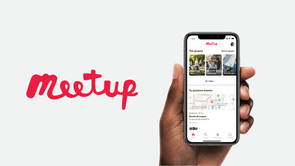 graphic with the meetup logo and a hand holding a phone with the meetup app open