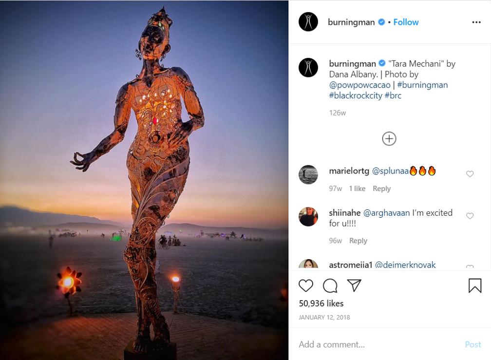 Event promoter content creators Burning man wooden woman sculpture