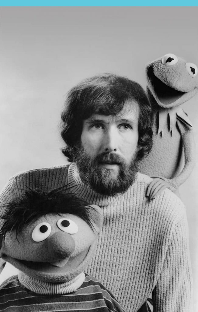Jim Henson photo with kermit and bert puppets. Companies started in a Recession.