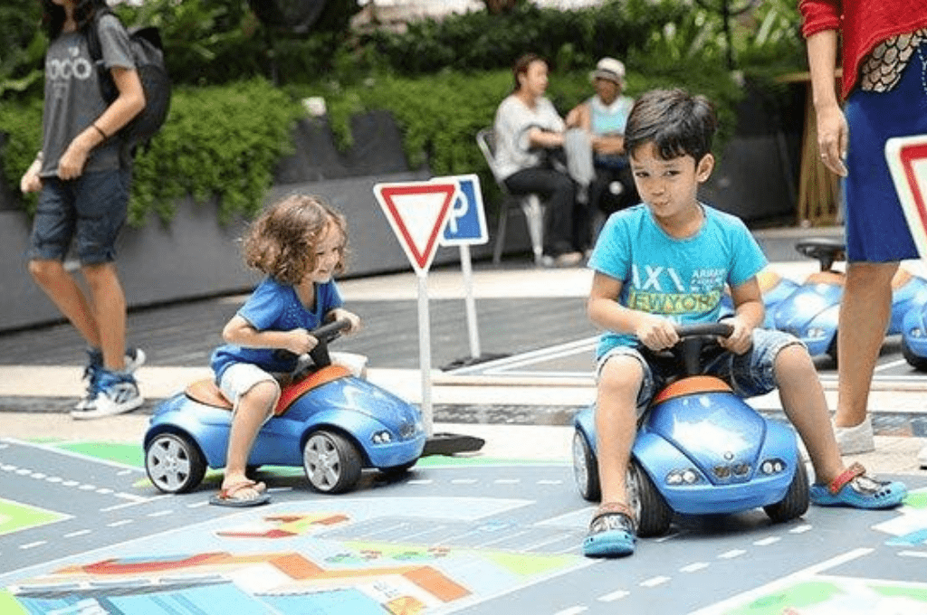 Toddlers driving toy cars