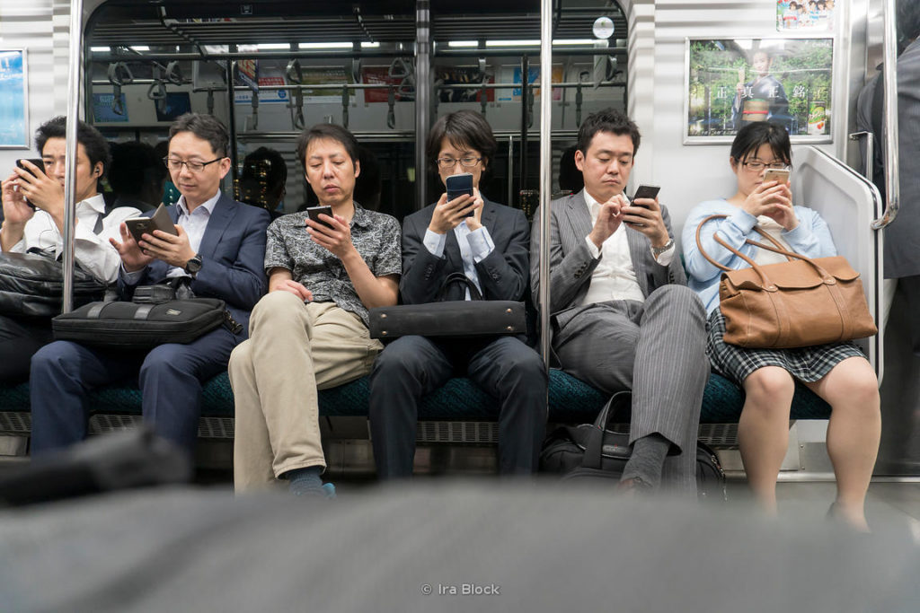 People with cell phones in a train in Tokyo, Japan