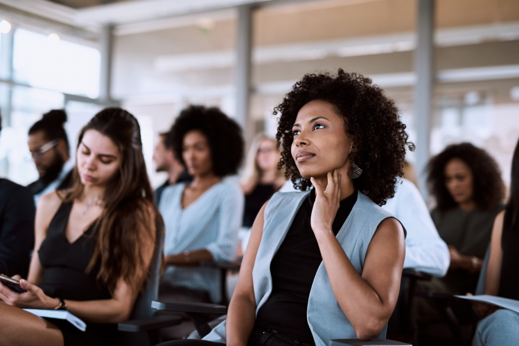 women attending a meeting and listening
