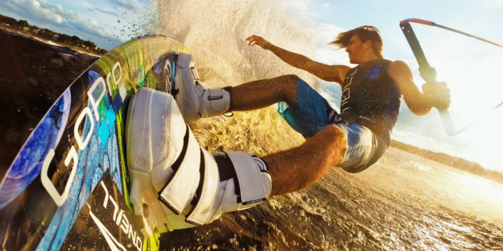 A man wakeboarding on a GoPro board.