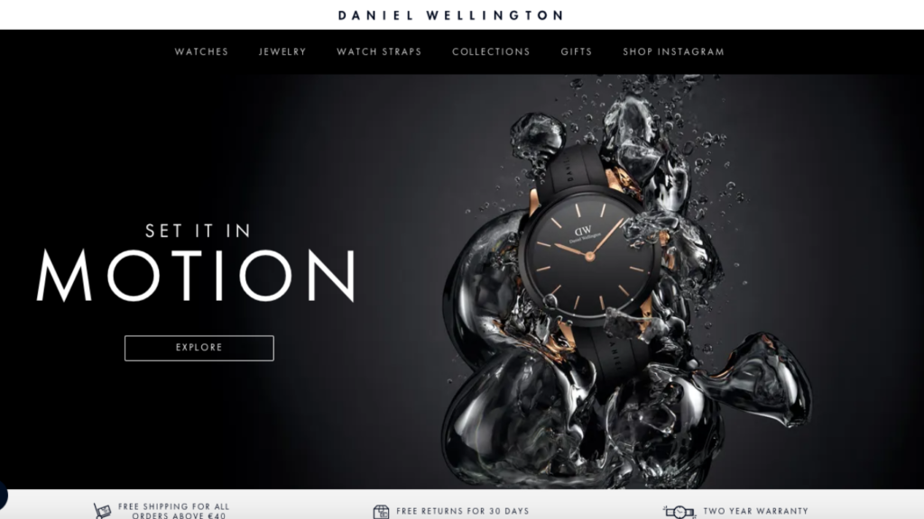 """A screenshot of Daniel Wellington home page. Black background with a black watch coming out of water on the right side and words """"Set it in motion"""" on the left."""