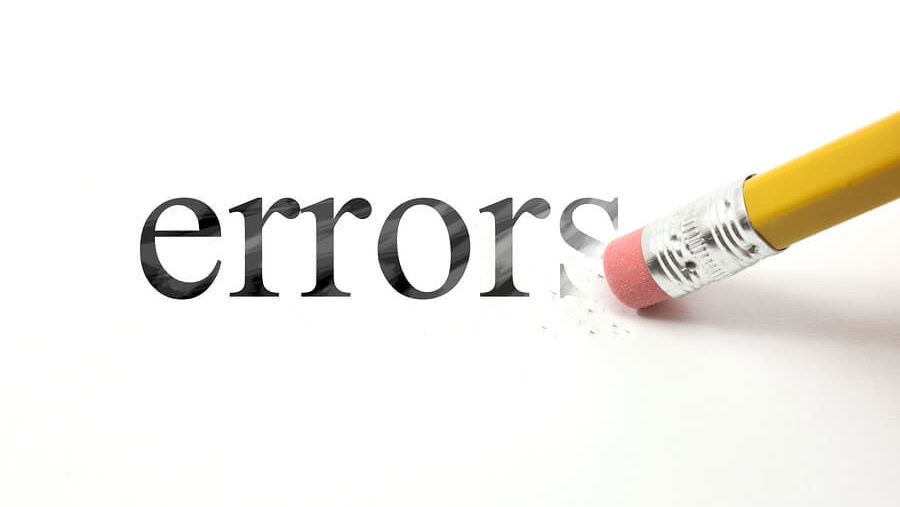 Word errors written over white background with a pencil rubber erasing the letters.