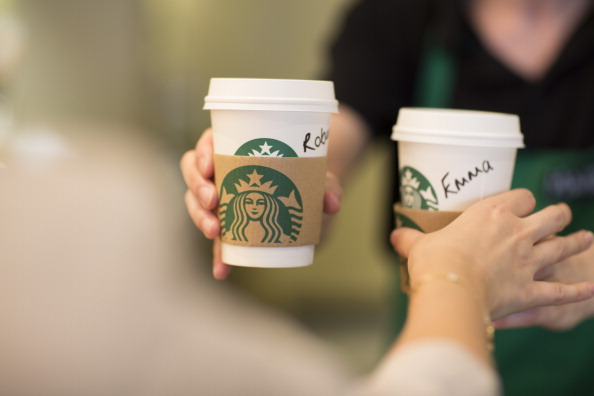 Personalized Starbucks coffee cups with a recognizable logo.