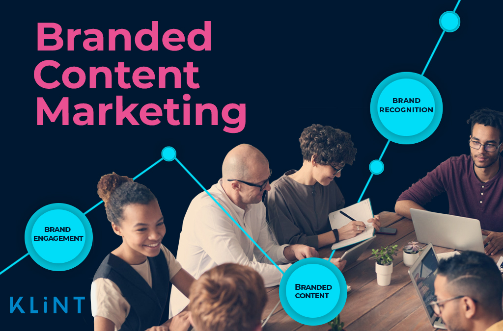 """A group of people sitting at a table having a business meeting. Text overlaid : """"branded content marketing"""""""