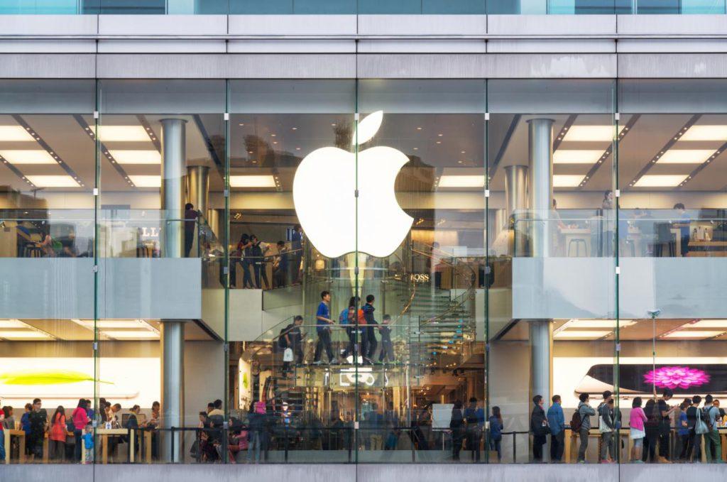 Customers standing in lines in Apple store.