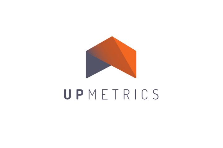 UpMetrics grey sign with an orange arrow on the top as a logo
