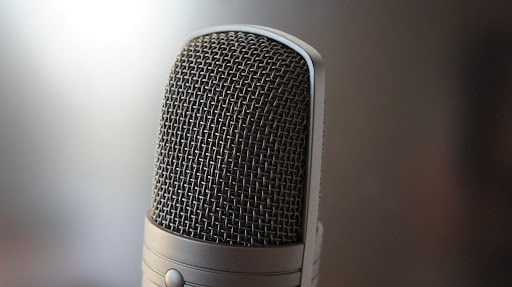 Picture of a black mic with blurred background